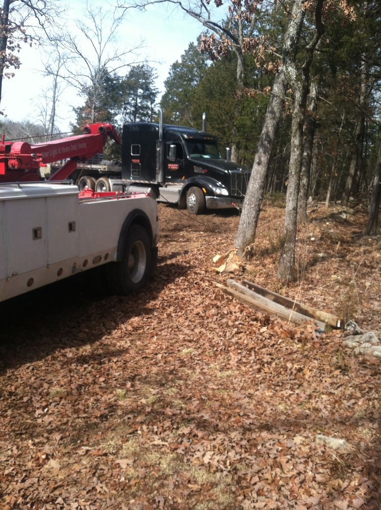 Towing semi-truck out of the woods