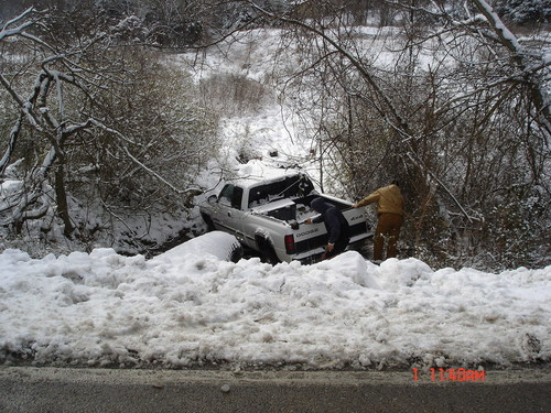 Truck in snowy ditch to be recovered