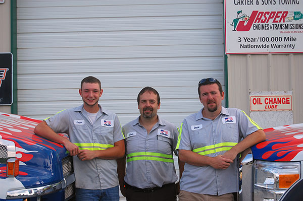 Jason, Daniel, and Kegan with 2 of our trucks